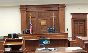 image of a courtroom - links to the Mediation page