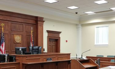 image of courtroom - links to Local Police Departments page